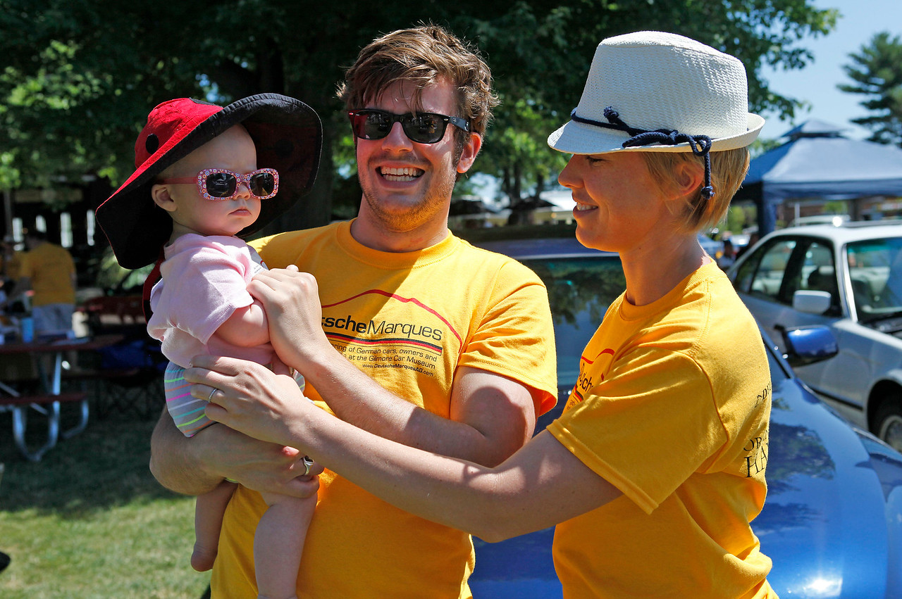 Lavinia Wooster, left, and her parents, Lewis and Corinn Wooster, all wore DeutscheMarques T-shirts to the show.
