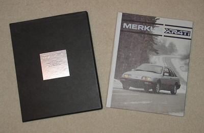 "Ford Merkur XRRTi very rare No. 192 of 250. 55 pages, hard bound. Comments by: Robert Rewey, Bob Lutz, ""Red"" Poling, Donald Petersen, Charles Knighton, Trevor Creed,"