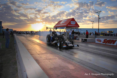 "The ""Nitro Junkie"" does a burnout at sunset."