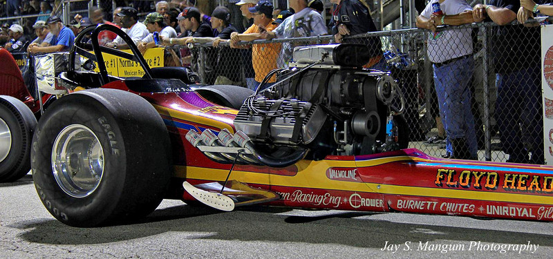 Floyd Head's dragster after the cackle. In the old days the open headers were kept sealed from the elements between runs with anything from beer cans to rubber balls on a chain. Budweiser serves the crew a dual purpose here.