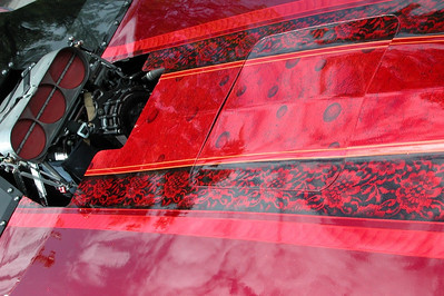 The Hard Guys Mustang had a fantastic candy red lace paint job.  Blown big block Ford under the glass.