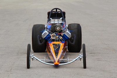 Telephoto front view of John Dearmore top fuel dragster.