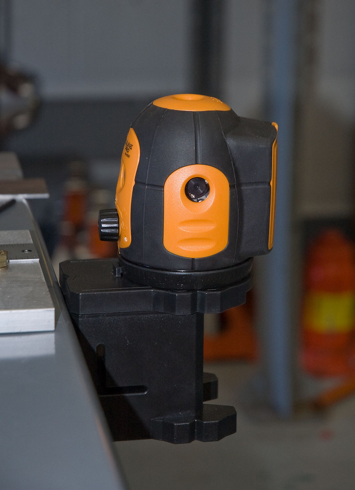 Laser level mounted to the rear of the chassis fixture.