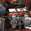 Two SU carburetors, 118 horsepower, 2.0 Liter engine.