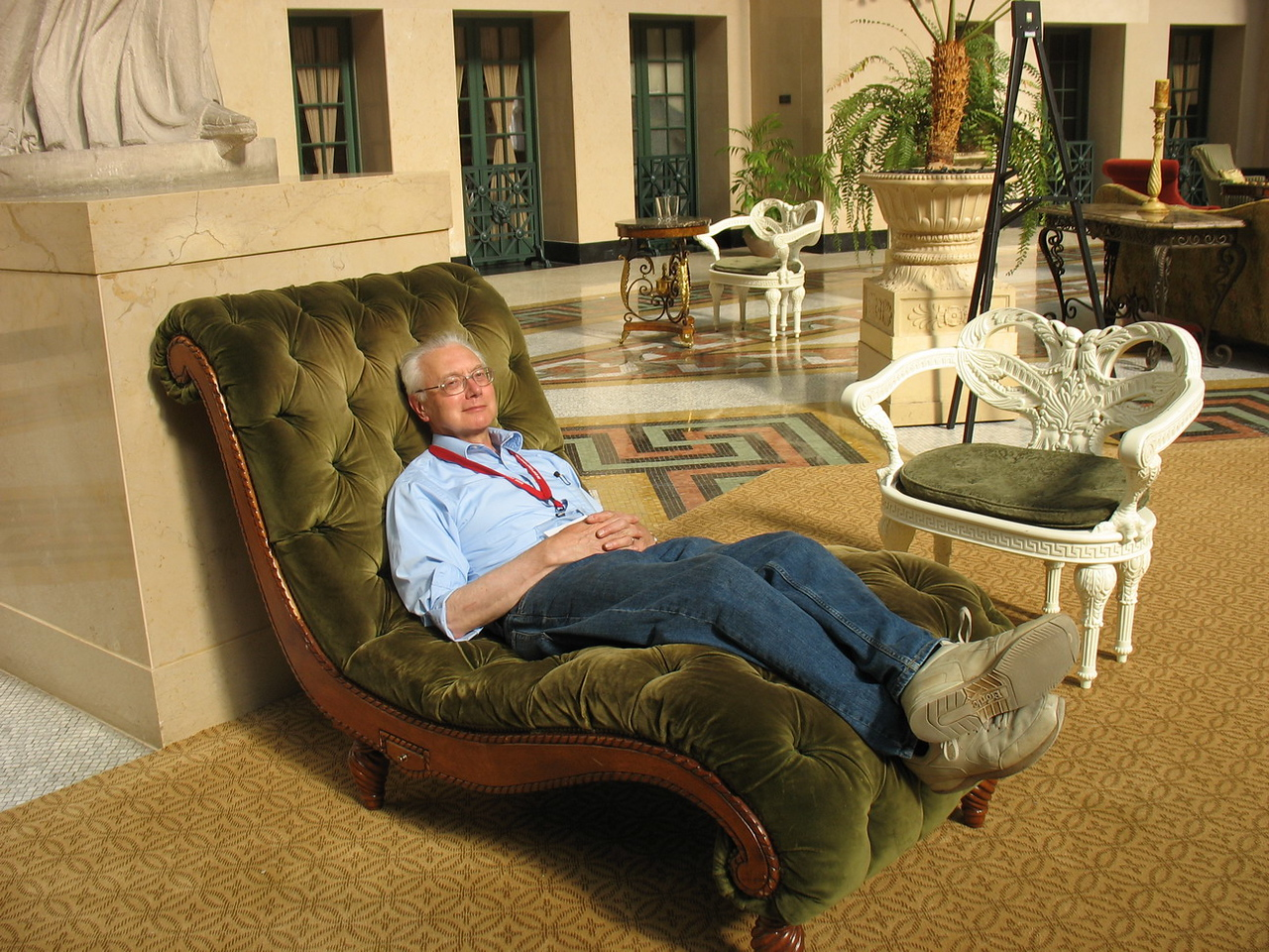 Bob reclining in the Atrium. These chaises are large enough for two people and are a great place to watch the changing colours of lights in the chandelier.