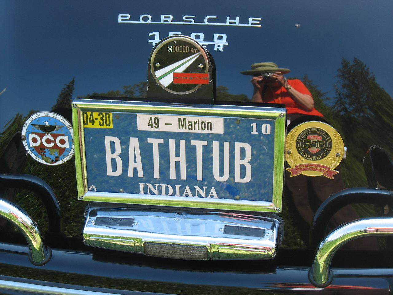 I caught my own reflection taking pictures of the various vanity plates. The restoration on many of these cars has left them with VERY shiny paint.