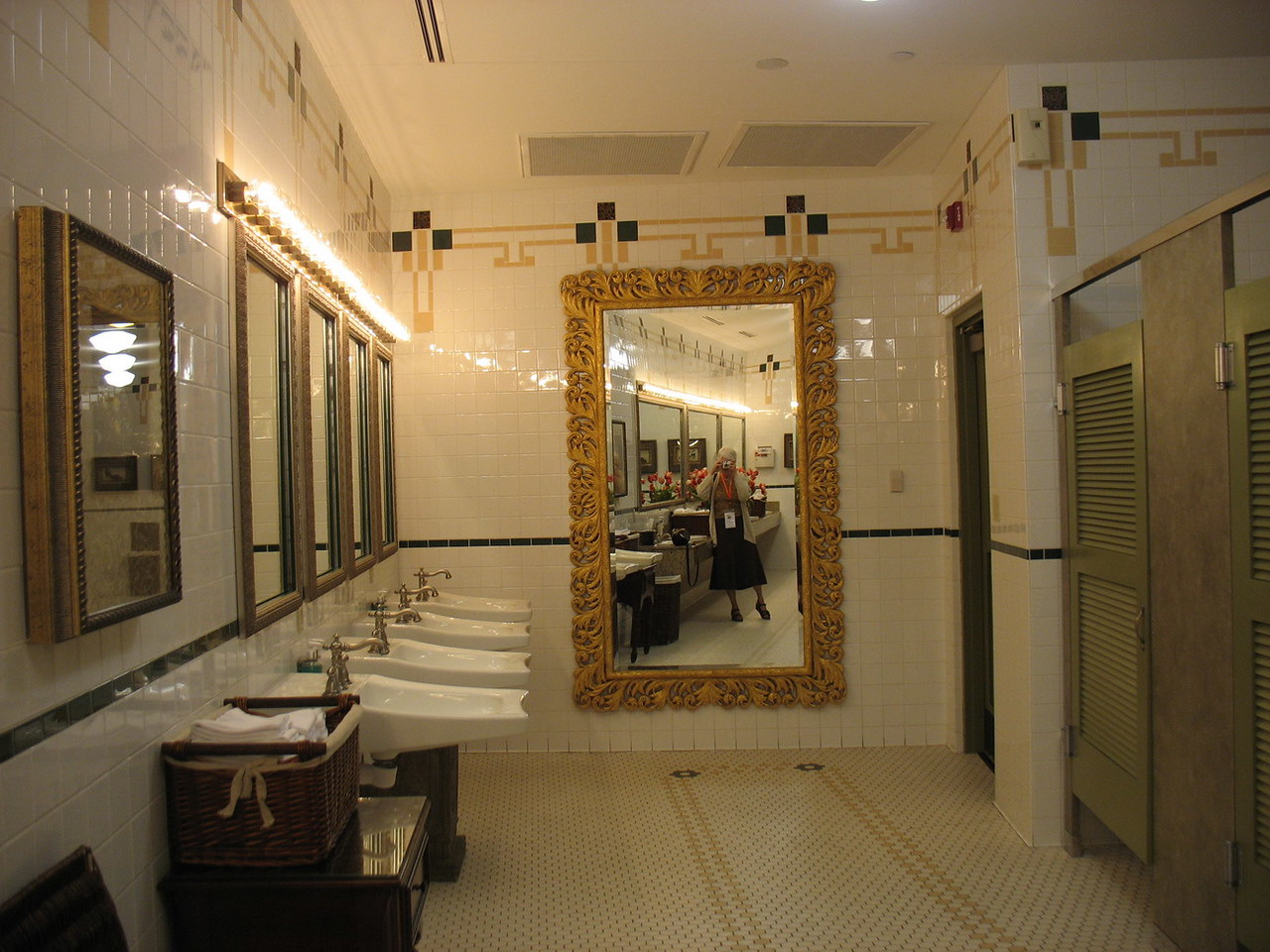 Me reflected in the large mirror at the end of the ladies' room. Note the row of original large sinks.