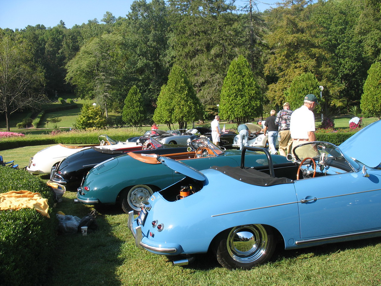 Other cars in the car show.