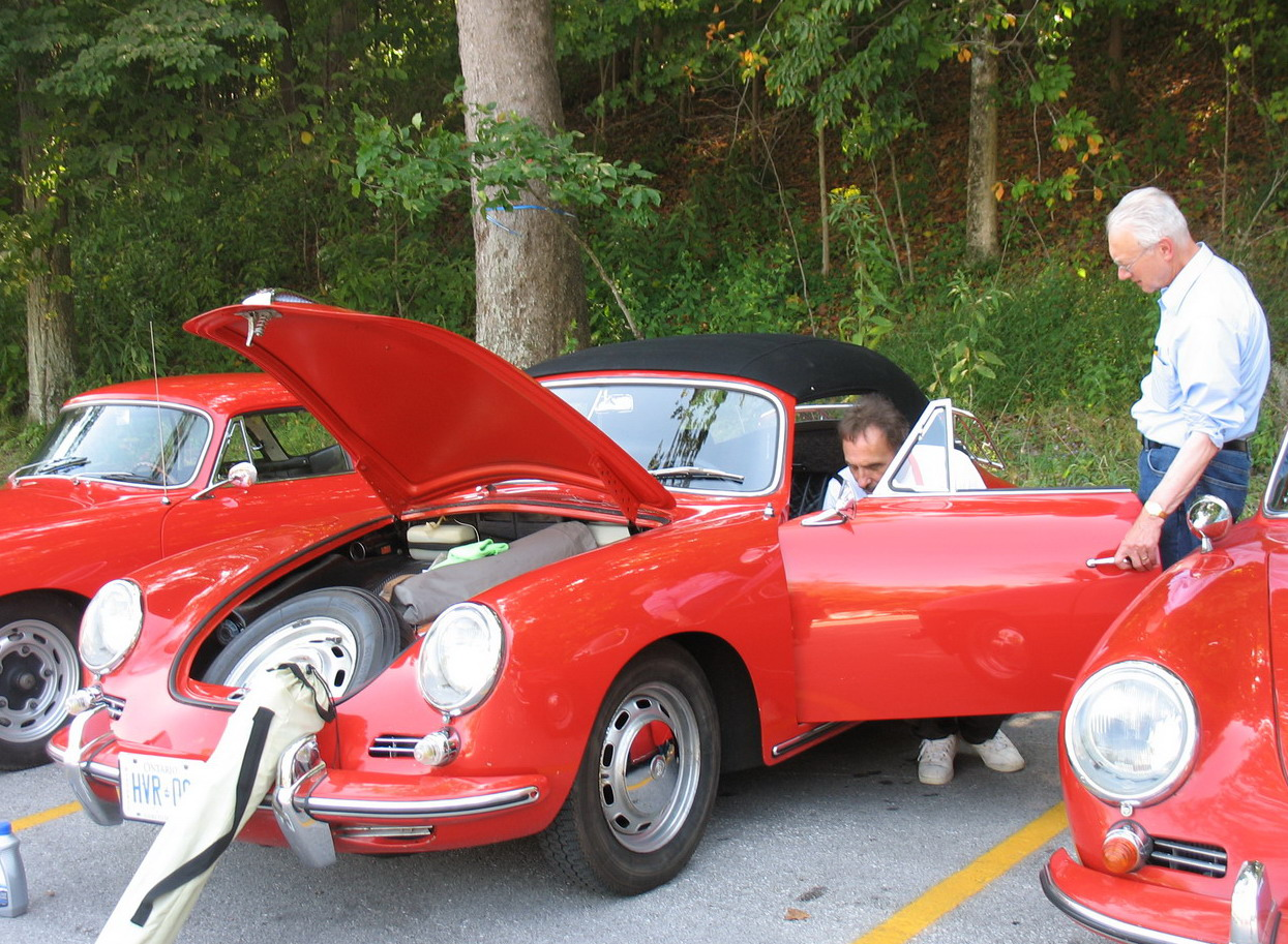 Comparing notes on the fine points of each car. Porsche company bought out Reutter, the company that made the 356 bodies, shortly before the end of the 356 model run. Our car is late enough that it has a plaque indicating it was Porsche built.