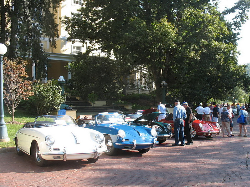 Other cars in the car show. Also a good view of the veranda of the hotel.