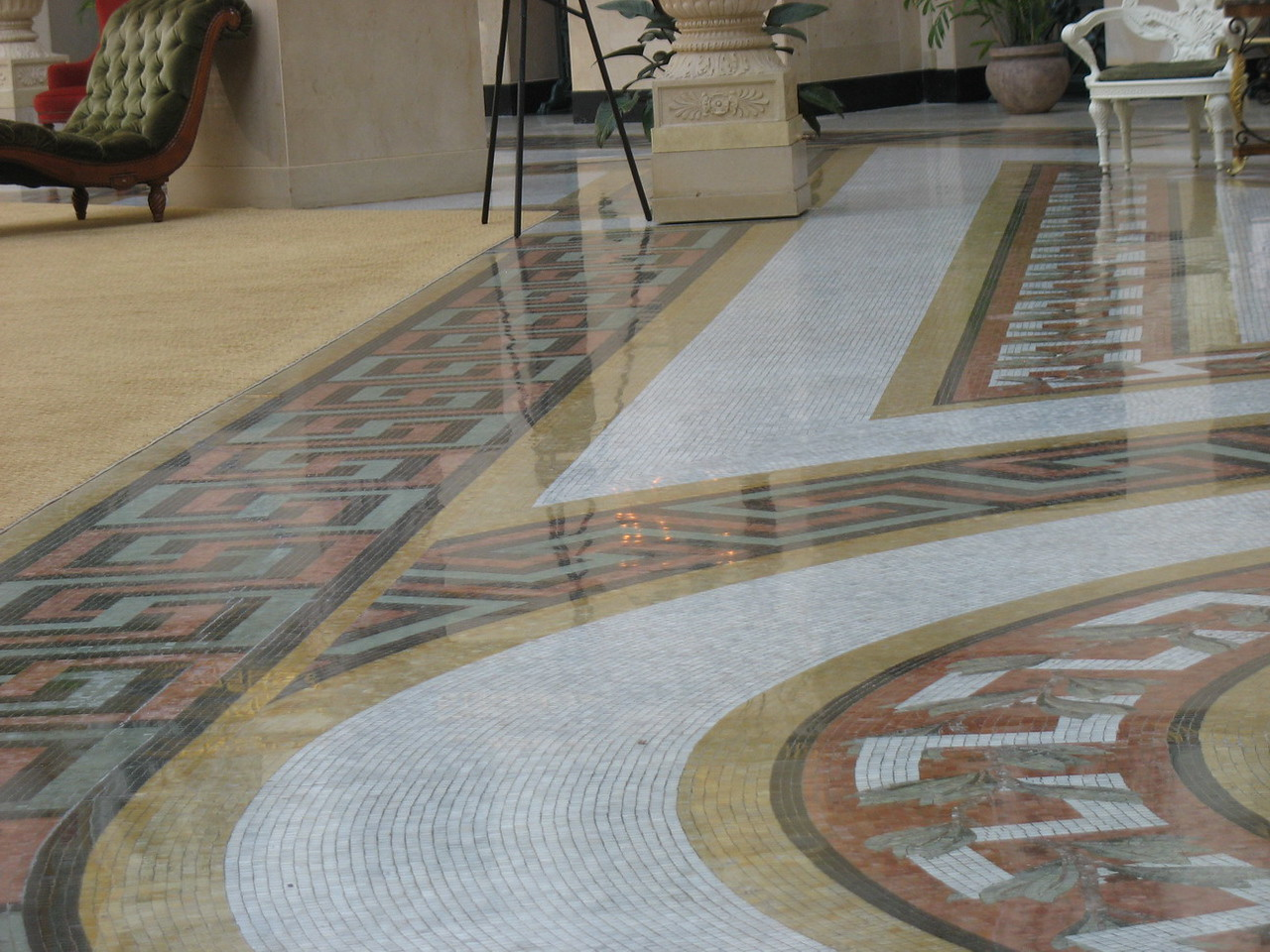 The marble cube floor which takes its cue from the chandelier. It remains in the perimeter of the atrium, but in the centre, the original floor was destroyed in the process of stabilizing the building and there is now a large carpet.
