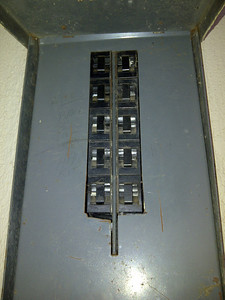 A front view of the electrical panel with the metal plate installed.