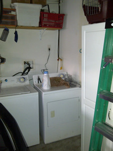 The washer and dryer. In the right upper corner is where the attic is.