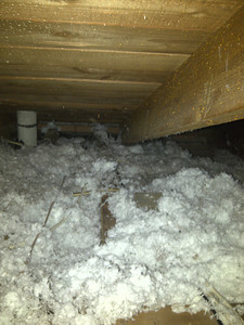 The attic view of where the wires are located. The foam covers much of the wires.