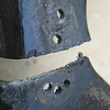Multiple rivets were used at top of wall.