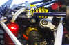 * Six-speed sequential gearbox<br /> * Quaife Auto Torque Bias sensing differential unit IRS<br /> * Reverse Gear<br /> * Options: Electronic push button or paddle shift.
