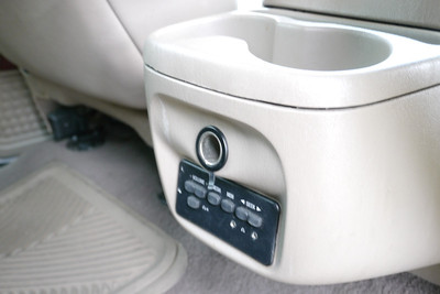 Second row has controls for headphones and power outlet.