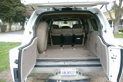 Rear cargo area with the third row folded up. This row is also removable.