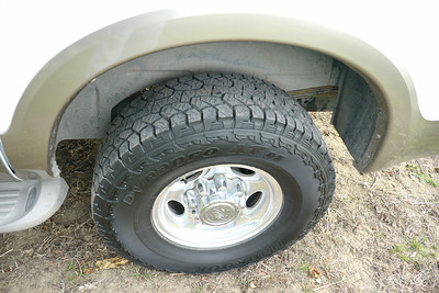 Same wheels and lugs and axles and frame as a Ford F350 Super Duty. It's a serious truck. Not an Escalade.