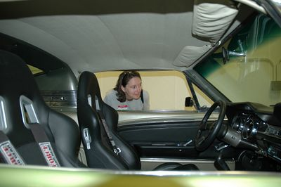 Wendy admires the race-ready interior of the Mustang.