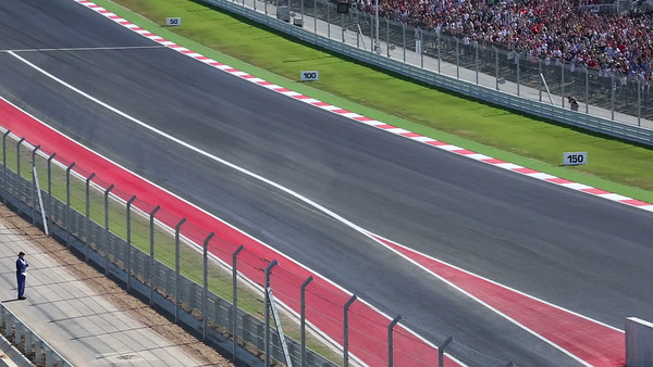 The first corner of the 2012 F1 in Austin.  Alonso, on the outside, went from 9th to 4th in this corner.  I was talking with the wife of the chief steward just before this.  She told me the clean side of the track was 18 km/h faster.  Ferrari pulled a move with a gear box change to get Alonso on the clean side for the start.