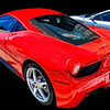 The body was designed by Pininfarina, as with all recent Ferrari models. The car's exterior styling and features were designed for aerodynamic efficiency, producing a downforce of 140 kg at 124 miles per hour (200 km/h).[4] In particular, the front grille features deformable winglets that lower at high speeds, in order to offer reduced drag.[9] The car's interior was designed using input from former Ferrari Formula 1 driver Michael Schumacher, including a new steering wheel design which incorporates many features and controls as opposed to their being on the dashboard, similar to racing car designs.[4]