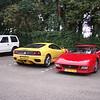 Ferrari 360 Modena (geel) en Ferrari 348 TB (rood).
