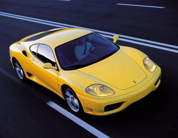 Ferrari 360 Modena In Motion Above 3 Quarter Front View
