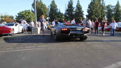 Lamborghini Reventon, being unloaded from a carrier. Also you will see a couple of Gallardo Superleggeras, a 355 Spider and a couple of Miuras, one is purple! All thanks to SuperCar Sunday in Woodland Hills, CA.   http://www.supercarsunday.com/