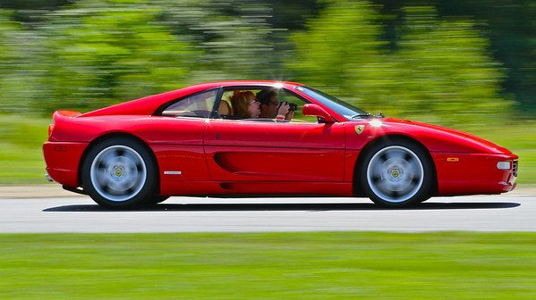 Shooting video while driving? At least he's not texting. Ferrari Challenge, Lime Rock Park
