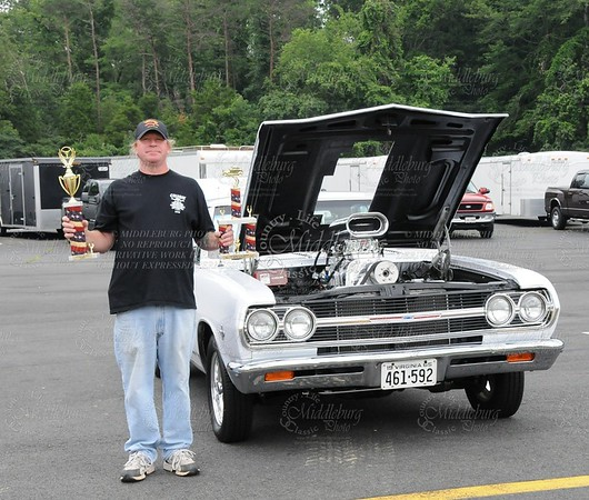 Earl and his 1965 Malibu, nice trophies! <br /> You are the most popular car in this gallery!