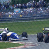 Damon Hill driving a Williams Renault following Gehard Berger driving a Ferrari at the 1994 Canadian Grand Prix