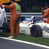 Ukyo Katayama's Tyrrell-Yamaha being removed after retirement at the end of the 1994 Canadian Grand Prix.