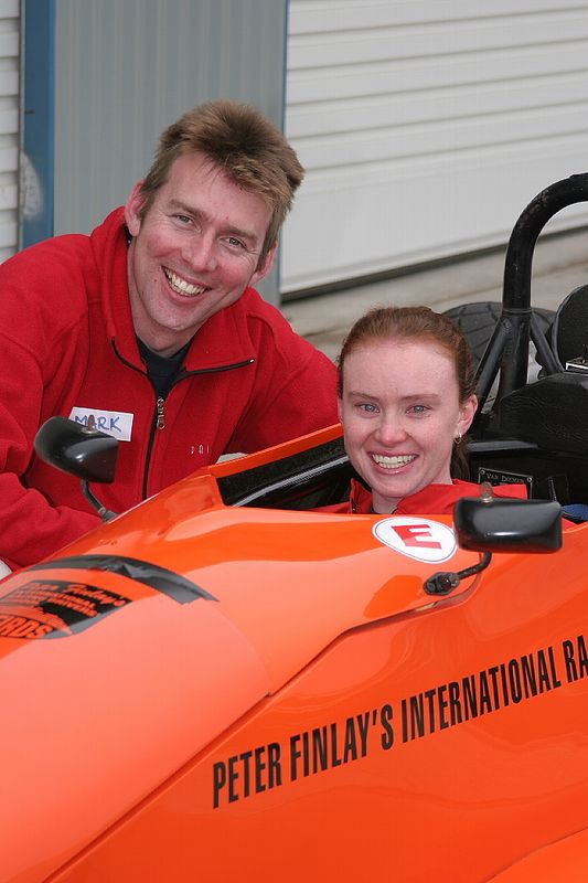 Megan Quinn and Mark Neal  in the orange RF 98 Van Diemen. Father's Day Oran Park.