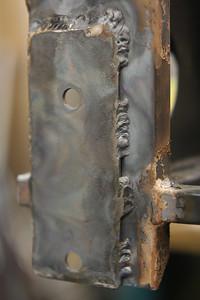 Right side, rear lower A-arm mount reinforced