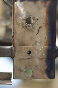 left side lower a-arm mount holes, front pivot, cleaned and ready for welding
