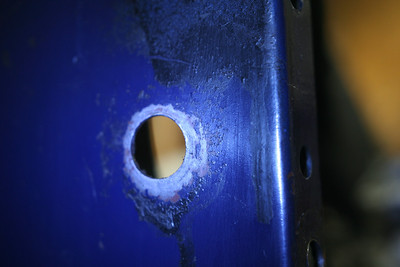 left side lower a-arm mount hole, rear pivot, upper hole
