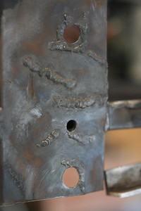 Right side, forward lower A-arm mount cracks welded prior to reinforcement