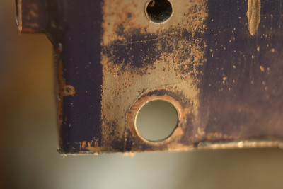 right side lower A-arm rear pivot lower mounting hole