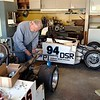 Bob Fox working on John Bosso's car.