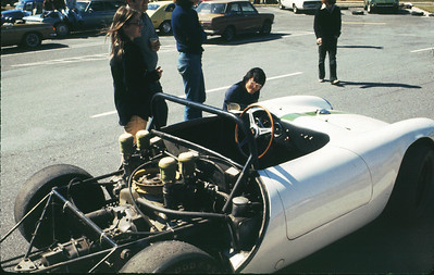 Ernie Cabrera adjust tire pressures at an autocross at Perimeter mall in Atlanta in 1975. His Porsche 550A Spyder had a flat fan 1700cc 4-cam motor putting out around 160 HP at 9000 RPM.