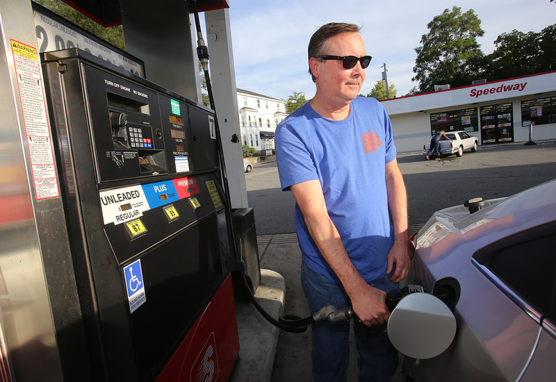 Randy Pearl of Lowell pumps regular gas at the Speedway station at Pawtucket and Wilder Streets in Lowell. He always gets regular because he knows that's all his car needs. (SUN/Julia Malakie)