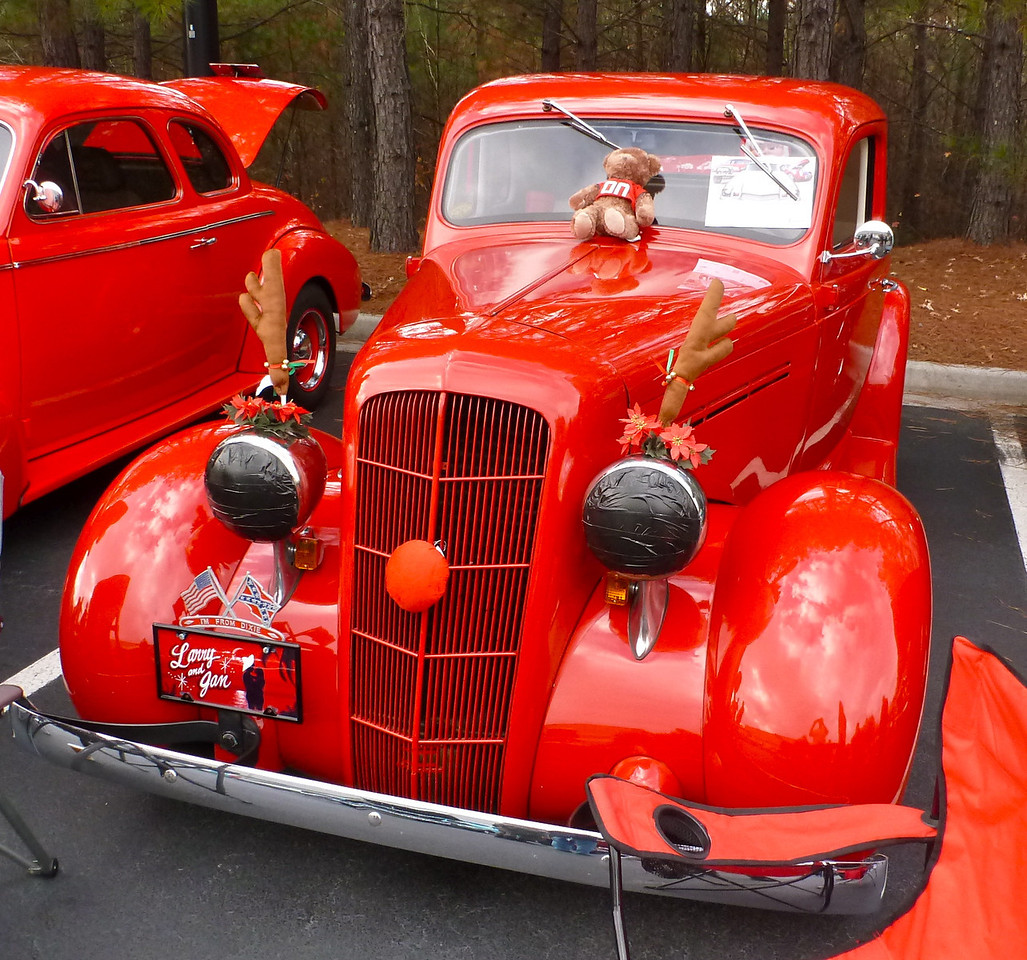 Trophy awarded for:<br />  BEST HOLIDAY SPIRIT<br /> <br /> 1935 Plymouth owner by Jen & Larry Henson