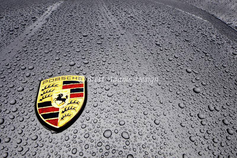 Porsche 997 Hood Crest - Rain close up