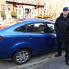 James Bresnahan of Lowell, on Appleton Street, with the donated Ford Fiesta he received from the Good News Garage, a non-profit that provides reliable transportation to people in need. (SUN/Julia Malakie)