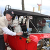 Lowell mayor Rodney Elliott says hello to Flossie, who belongs to Tom Gallagher of Lowell, right, also the owner of the replica 1923 Ford T Bucket. They were at the news conference to announce that the 2014 Great Race will stop at Lowell for the first time on Saturday, June 21, 2014. (SUN/Julia Malakie)