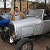 Randy Christian of Tyngsboro, with the 1928 Ford Model A Roadster he found in a Dracut swamp in 1971 when he was seven years old, and eventually took out piece by piece and rebuilt. (SUN/Julia Malakie)