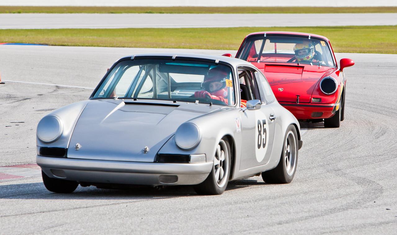 Blake DeFoor in 1969 Porsche 911S trails Craig Taylor in 1968 Porsche 911