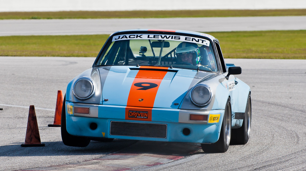 Jack Lewis lifts front right wheel of IROC 1974 Porsche RSR