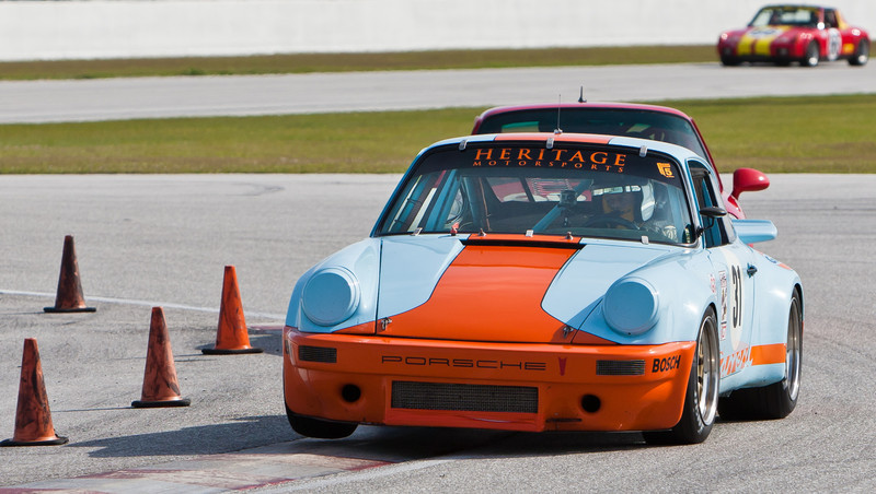 George Tuma's 1973 IROC Porsche RSR lifts right front wheel in exiting turn 2